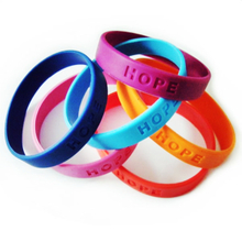 Custom promotional silicone bracelets with debossed embossed logo