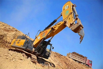 Excavator with Rocky boom